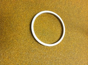 Move the ring around on a sheet of sandpaper to remove rough adges and make it more uniform.